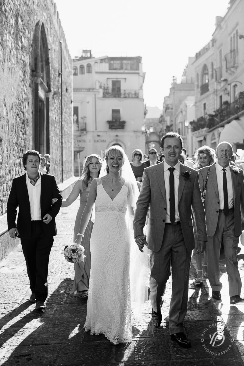 "Newly weds walking through the streets of Taormina to shouts of ""Auguri"""
